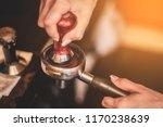 barista's hands with tamper.... | Shutterstock . vector #1170238639