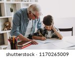 grandson doing school homework... | Shutterstock . vector #1170265009