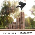 businessman walk on stack of... | Shutterstock . vector #1170286270