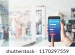 woman holding smartphone to... | Shutterstock . vector #1170297559
