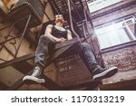 portrait of a punk man in the... | Shutterstock . vector #1170313219