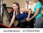 personal trainer helping sporty ... | Shutterstock . vector #1170322540