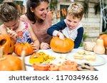 young kids carving halloween | Shutterstock . vector #1170349636