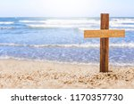 wooden cross on beach with... | Shutterstock . vector #1170357730
