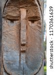 wooden totem pole with human... | Shutterstock . vector #1170361639