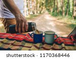 man hand pour on coffee into... | Shutterstock . vector #1170368446