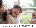 parent feeding bread to child... | Shutterstock . vector #1170417619