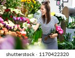 cheerful young florist at work. ... | Shutterstock . vector #1170422320