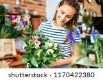 portrait of smiling florist...   Shutterstock . vector #1170422380