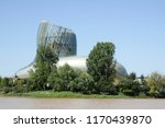 Small photo of Bordeaux, Nouvelle aquitaine / France - 09 02 2018 : Cite du Vin museum from boat position on river port of entry to Bordeaux vineyards