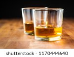 glass of alcoholic drink wooden ...   Shutterstock . vector #1170444640