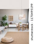 pouf on brown carpet in... | Shutterstock . vector #1170495199