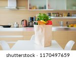paper shopping bag full with... | Shutterstock . vector #1170497659
