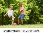 two children in duel playing... | Shutterstock . vector #1170498826