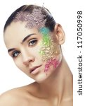 woman with cracked coloured powder on face on white background - stock photo
