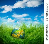 globe lies on green grass.... | Shutterstock . vector #1170512170