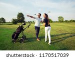 young sportive couple playing... | Shutterstock . vector #1170517039