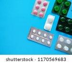 different pills on a blue... | Shutterstock . vector #1170569683