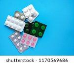 different pills on a blue... | Shutterstock . vector #1170569686