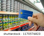 supermarket aisle and male hand ... | Shutterstock . vector #1170576823