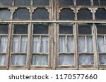vintage windows with curtains | Shutterstock . vector #1170577660