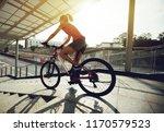 riding bike down ramp of... | Shutterstock . vector #1170579523