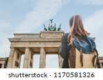 a tourist girl with a backpack... | Shutterstock . vector #1170581326