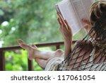 woman lying in a hammock in a... | Shutterstock . vector #117061054