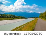 A view of the river Rhine across the international border between Liechtenstein and Swizerland - stock photo