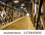 In side the old wooden bridge on the border between Liechtenstein and Swizterland - stock photo