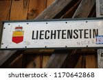 The international border post on the old wooden brdge across the river Rhine between Liechtenstein and Swizterland - stock photo
