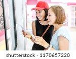 two happy girls friends looking ... | Shutterstock . vector #1170657220
