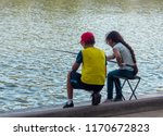 Boy And Girl On The Shore Of...
