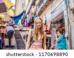 woman traveler choose souvenirs ...   Shutterstock . vector #1170698890