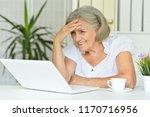 portrait of a senior woman... | Shutterstock . vector #1170716956