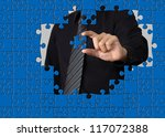 Business concept: Hand holding one pieces of a puzzle - stock photo