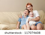 happy mother with two children... | Shutterstock . vector #117074608