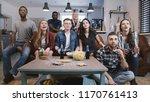mixed race friends watch sports ... | Shutterstock . vector #1170761413