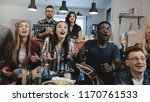 multi ethnic fans go crazy...   Shutterstock . vector #1170761533