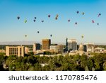 Colorful ballons in a blue sky over the little city of Boise Idaho