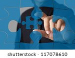 Missing jigsaw puzzle piece, business concept for completing the final puzzle piece - stock photo