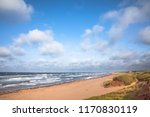 deserted beach and choppy seas  ...   Shutterstock . vector #1170830119