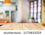 empty wooden table blurred of... | Shutterstock . vector #1170833329