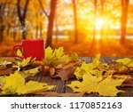 autumn leaves and hot steaming... | Shutterstock . vector #1170852163