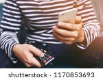 young man using television... | Shutterstock . vector #1170853693