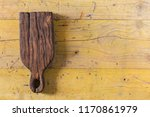old chopping board on wooden... | Shutterstock . vector #1170861979