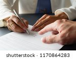 female hand signing contract. | Shutterstock . vector #1170864283