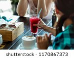 meeting friends in a cafe ... | Shutterstock . vector #1170867373