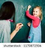 little girl in classroom with... | Shutterstock . vector #1170872506