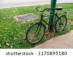 old bicycle parked by footpath   Shutterstock . vector #1170895180